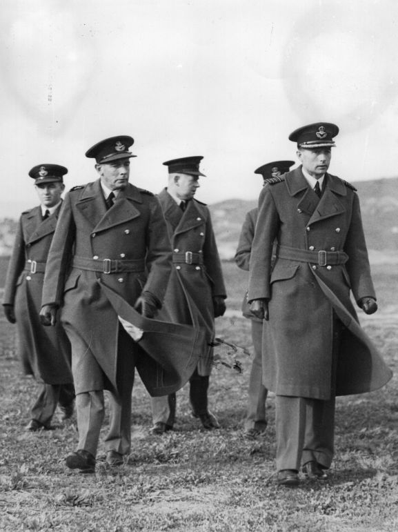 Image from the LM Isitt personal album collection. RNZAF officers at Rongotai. L-R: unknown, L.M. Isitt, Buckley [?], obscured, Wing Commander Ralph Cochrane