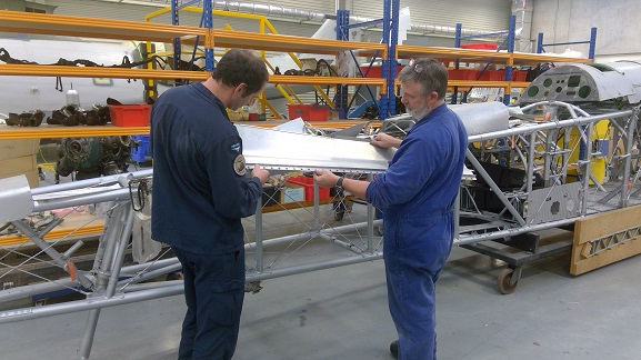 Project Supervisor PJ Smith and Airframe Technician Cpl Tim De Roo from the Museum's conservation team assess the present state of Vildebeest NZ102 prior to recommencing work on the aircraft.