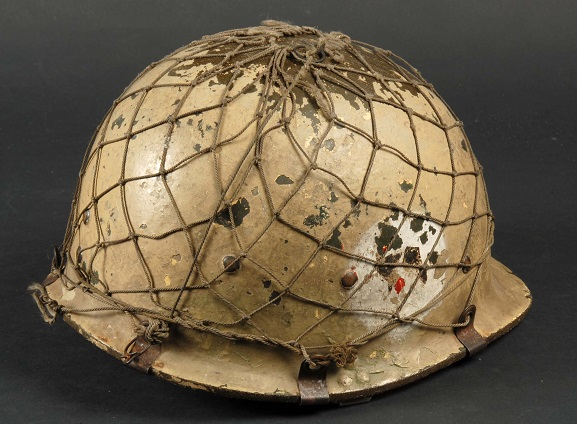 Iraqi military helmet, found in the desert after the 1990-91 Gulf War by an RNZAF Air Loadmaster. From the collection of the Air Force Museum of New Zealand.
