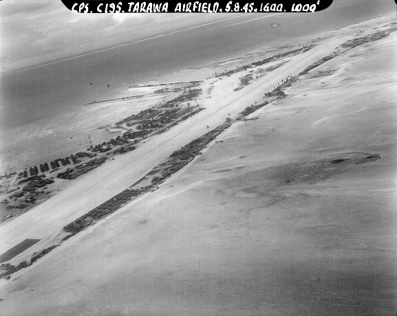 Aerial oblique view of the United States Hawkins Field airstrip on Betio, Tarawa Atoll. Gilbert Islands, 5 August 1945. Image ref CPSTin7frame5, RNZAF Official.