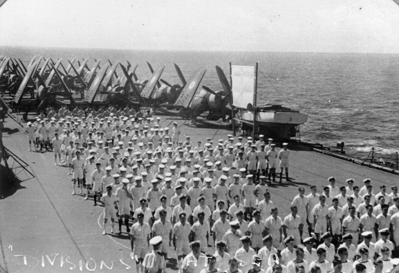 Image from the W Ford personal album collection.  Royal Navy personnel and RNZAF Corsairs on the flight deck of HMS 'Glory', March 1946. Image ref ALB922911019, Air Force Museum of New Zealand.