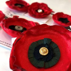 promise poppy brooches